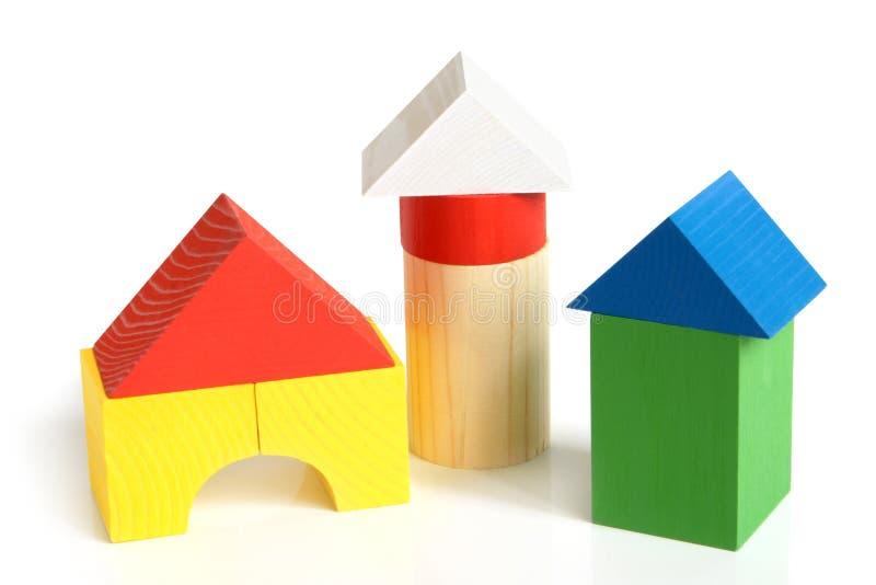 block som bygger barnhuset, gjorde s trä royaltyfria bilder
