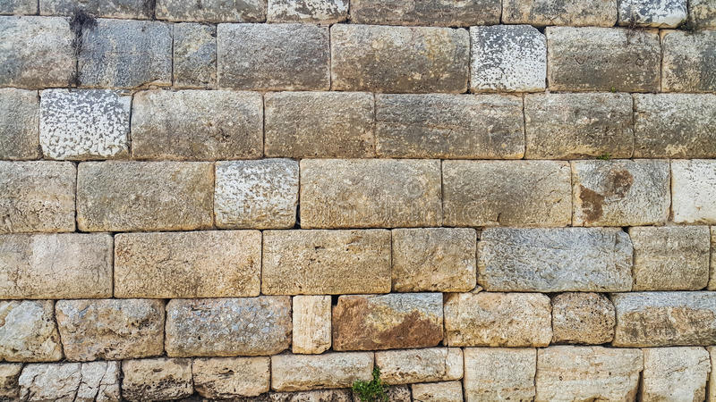 Block stone wall of ancient church royalty free stock image