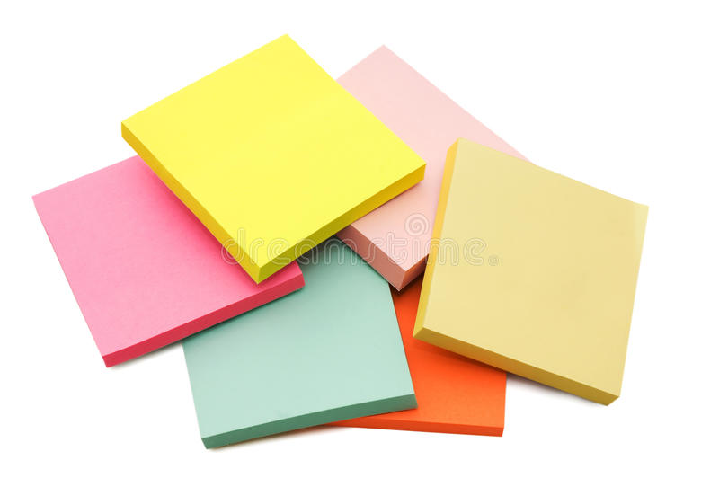 Block of vibrant multicoloured Post it Notes. Isolated on white royalty free stock images