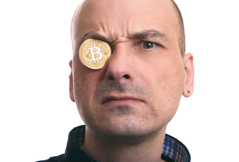 Blockchain mining. Portrait of a man with bitcoin coin royalty free stock photography