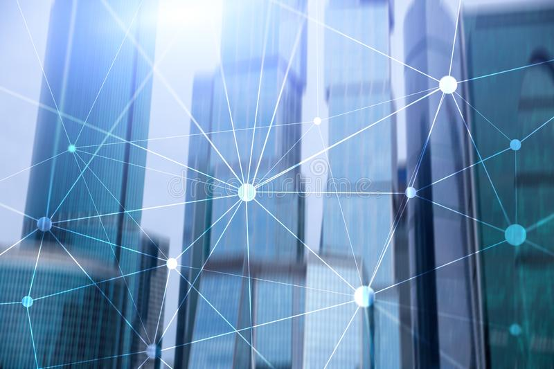 Blockchain network on blurred skyscrapers background. Financial technology and communication concept stock images