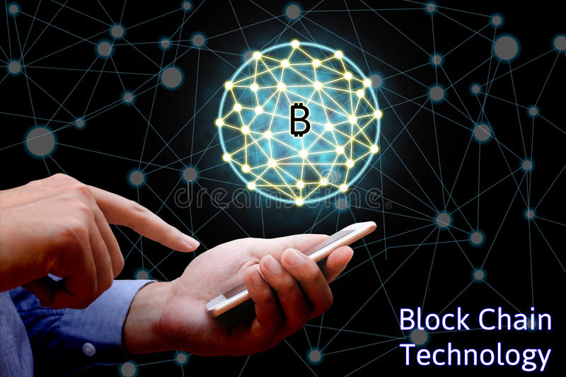 Blockchain technology concept, Businessman holding smartphone an. D virtual system diagram bitcoin and network background