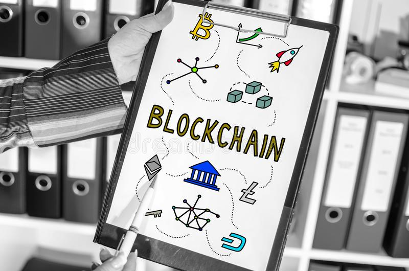 Blockchain technology concept on a clipboard stock images