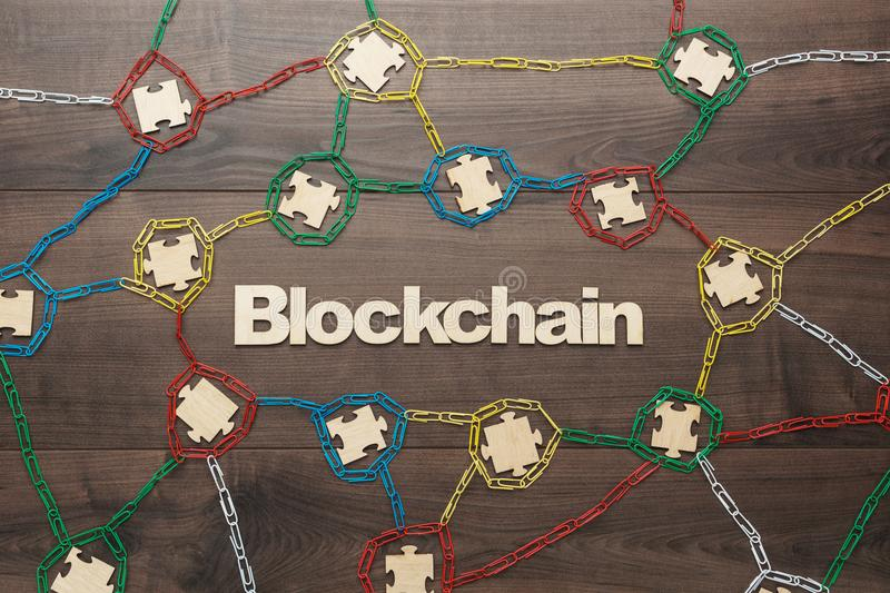 Concept of blockchain. Blockchain technology concept depicted with paperclips and puzzle pieces stock image