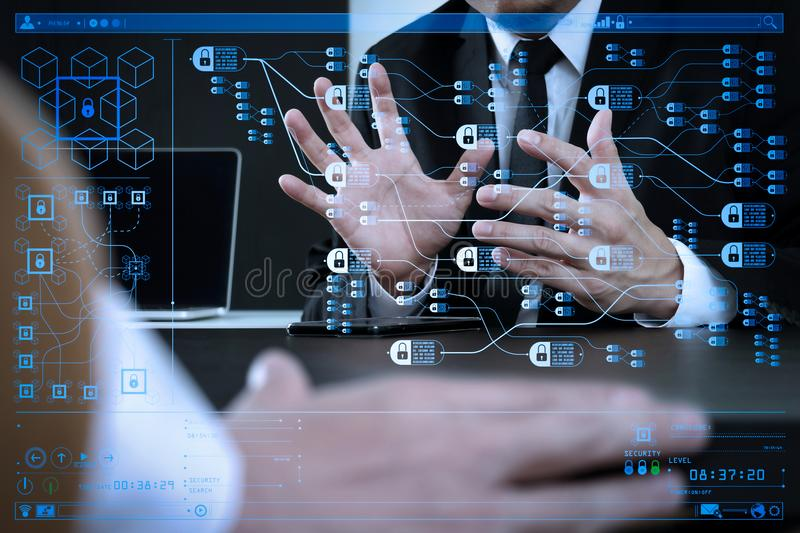 Co working team meeting concept,businessman using smart phone an. Blockchain technology concept with diagram of chain and encrypted blocks.Co working team stock image