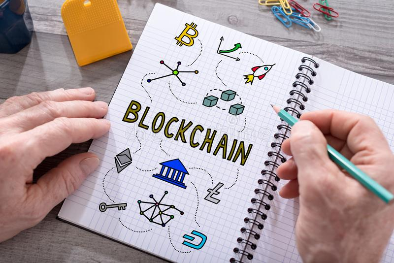 Blockchain technology concept on a notepad stock photos