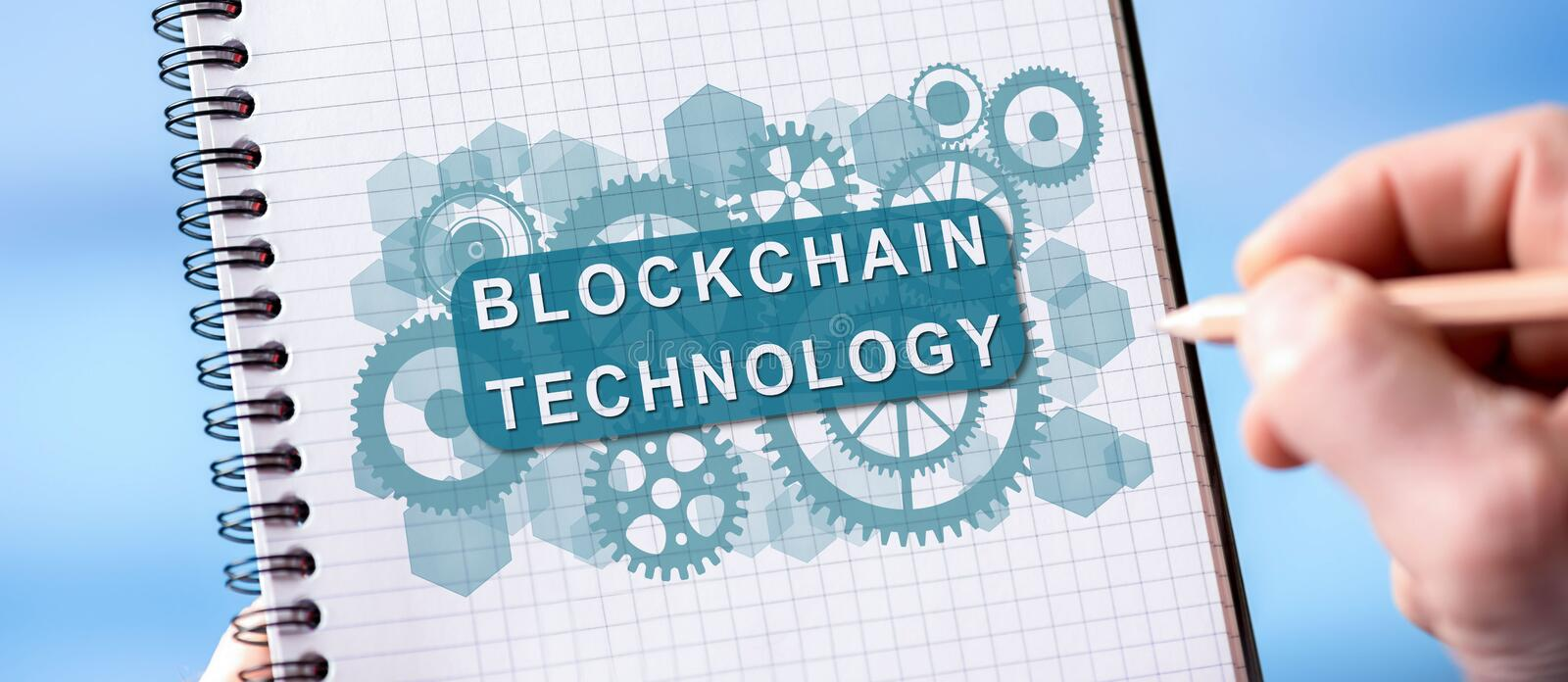 Blockchain technology concept on a notepad stock images