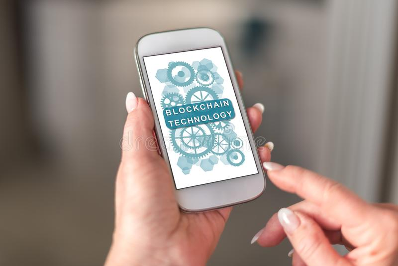 Blockchain technology concept on a smartphone. Held by a hand stock photo