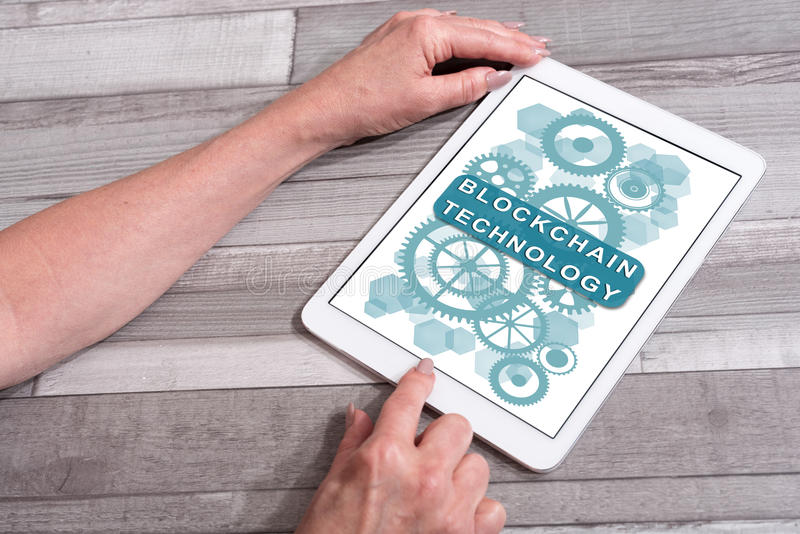 Blockchain technology concept on a tablet. Blockchain technology concept shown on a tablet used by a woman royalty free stock photos