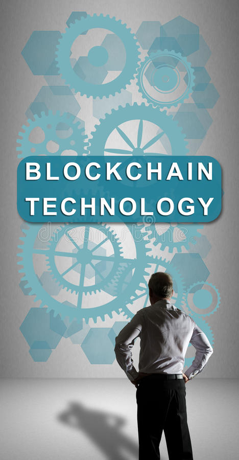 Blockchain technology concept watched by a businessman. Businessman watching a blockchain technology concept drawn on a wall stock images