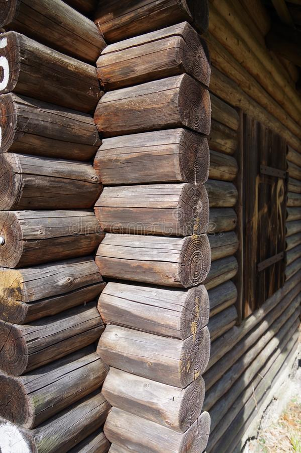 Blockhouse made of roundwood - detail. Round wooden beams interlocked, Corner connection at the blockhouse, round wooden beams with visible grain, wooden hut royalty free stock image