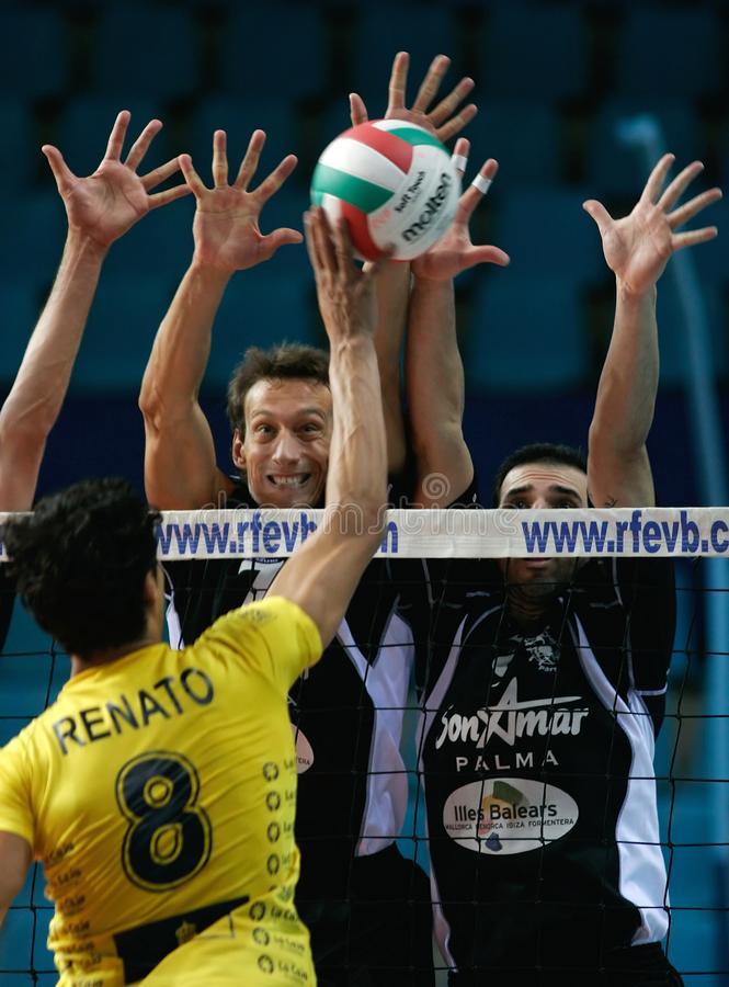 Men volleyball champions league game in Mallorca. Blocking a shot during a leg of the European Volleyball team championship held in the island oj Mallorca, Spain stock image