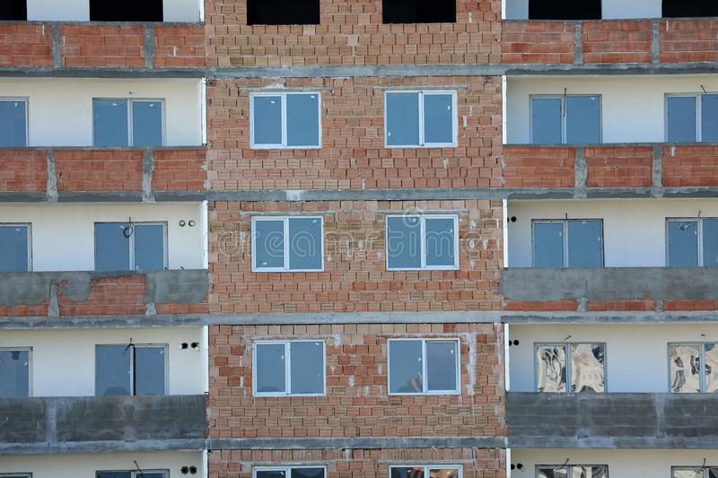 Blocks of flats in construction. New residential block of flats, real estate industry. Wall of bricks royalty free stock photos