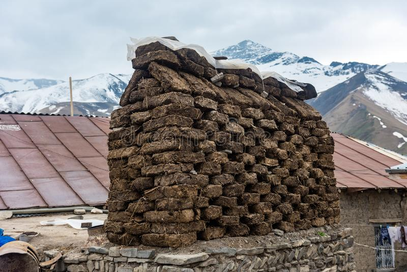 Blocks from manure are used as fuel for heating the house during the cold period. Blocks from manure are used as fuel for heating the house during the cold royalty free stock photo
