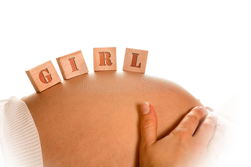 Blocks on pregnant belly royalty free stock photo
