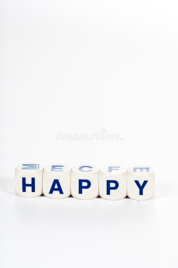 Blocks spell the word Happy royalty free stock photo