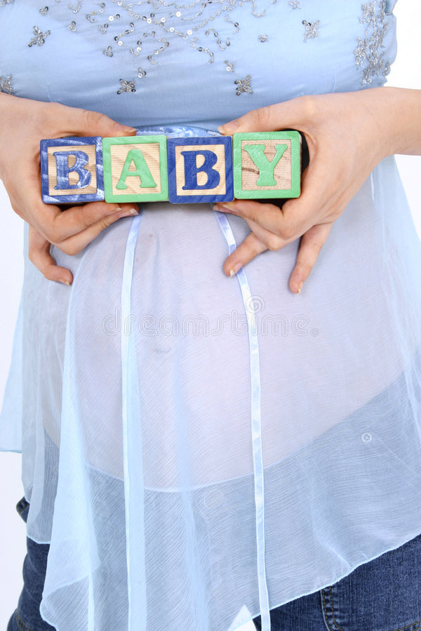Download Blocks Spelling Baby Above Expecting Mom's Belly Stock Photo - Image of daddy, beginning: 162568
