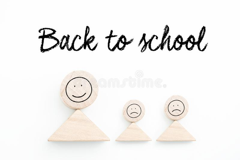 Blocks symbolizing parent with kids and the sentence `Back to School ` in German. On white background royalty free stock photography