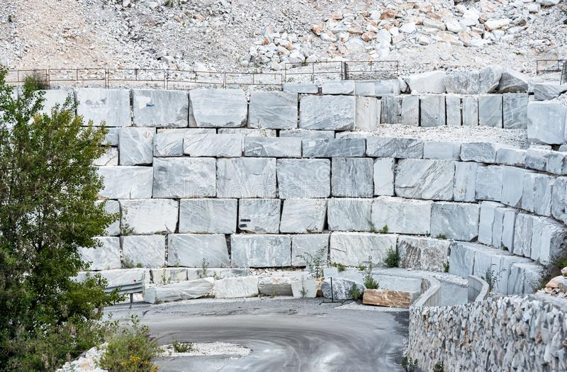 Blocks of white marble in the marble quarry of Carrara in Tuscany, Italy royalty free stock image