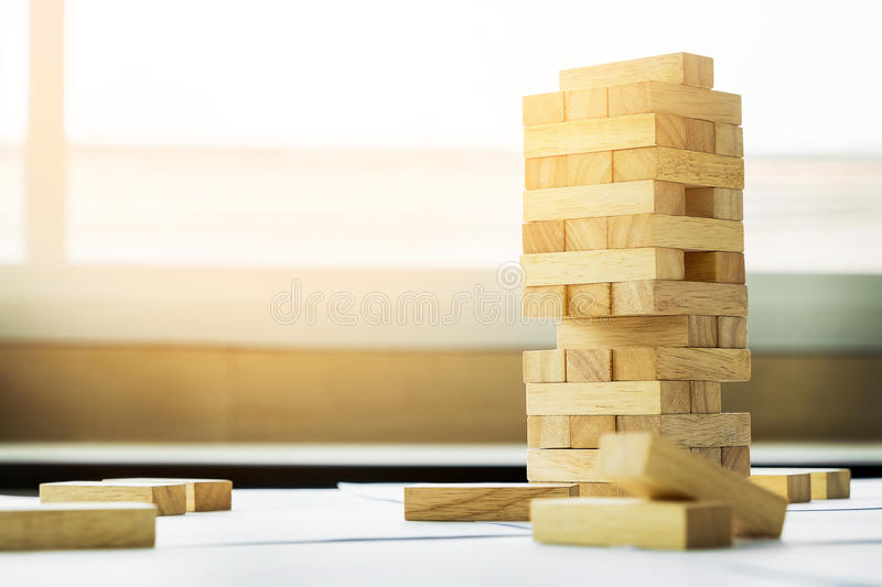 the blocks wood tower game with architectural engineer plans or royalty free stock photos