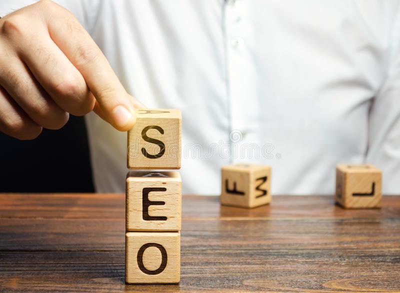 Blocks with the word SEO and businessman. Search Engine Optimization. Increase the quality and quantity of website traffic by royalty free stock images