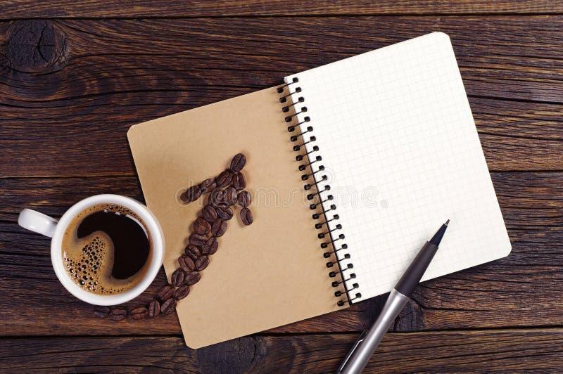 Blocnote en kop van koffie royalty-vrije stock fotografie