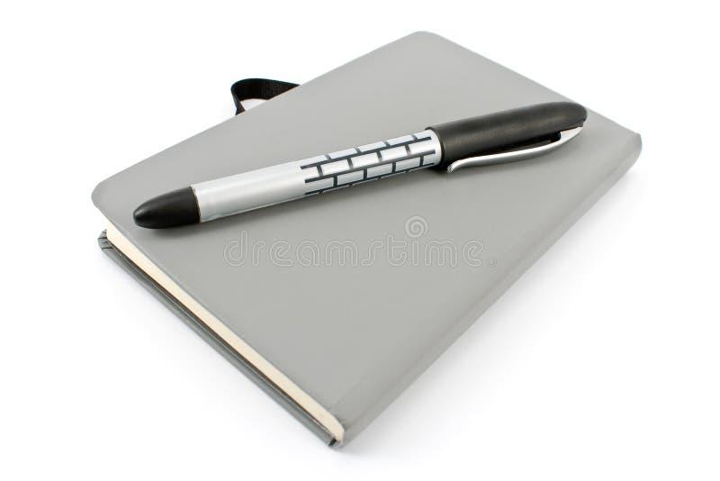 Blocnote en pen royalty-vrije stock foto