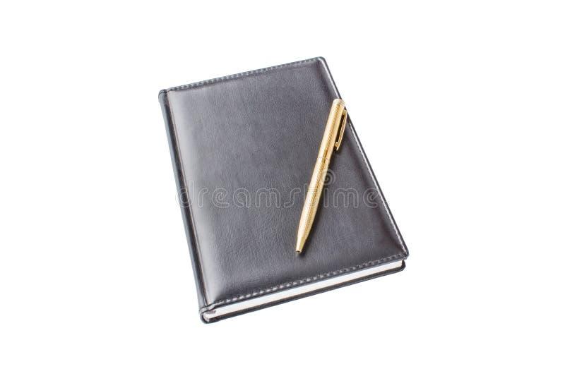Blocnote met pen stock foto's