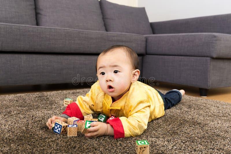 Bloco chinês do brinquedo do jogo do bebê imagens de stock royalty free