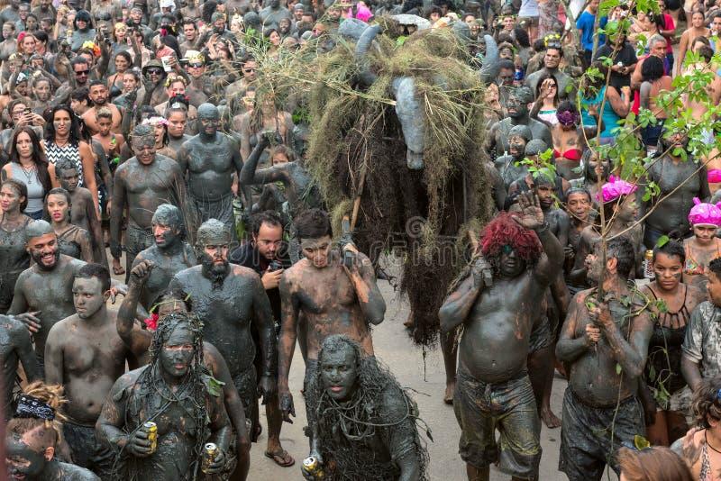 Bloco da Lama – Dirty Carnival in Paraty, Rio de Janeiro State. Paraty, Rio de Janeiro State, Brazil – February 25, 2017: Clad in swimwear and rags royalty free stock photos
