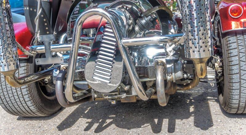 Bloco de motor cromado de um trike foto de stock