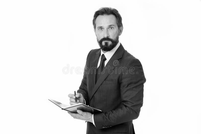 Bloco de notas da posse da programação do planeamento do homem de negócios Gestão de tempo e habilidade de organização Cara conce imagem de stock