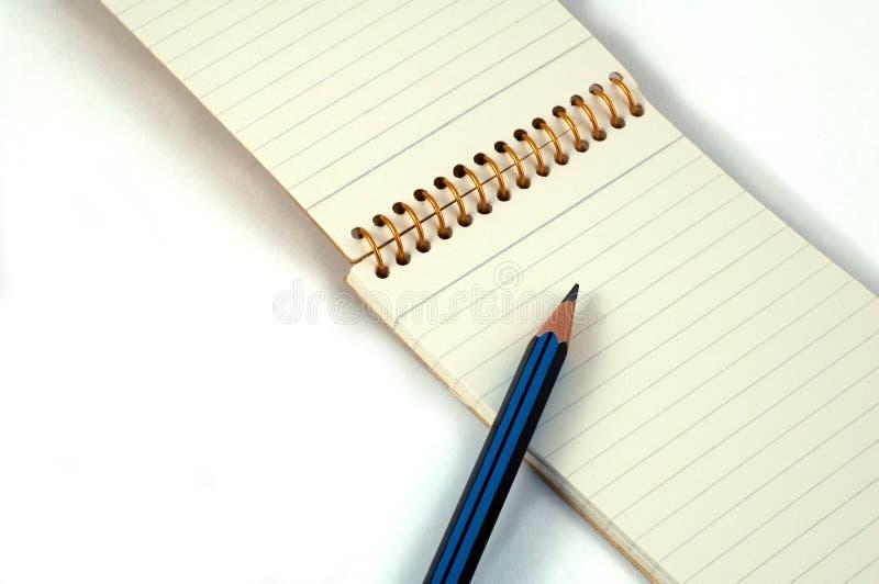 Bloco de notas e lápis imagem de stock