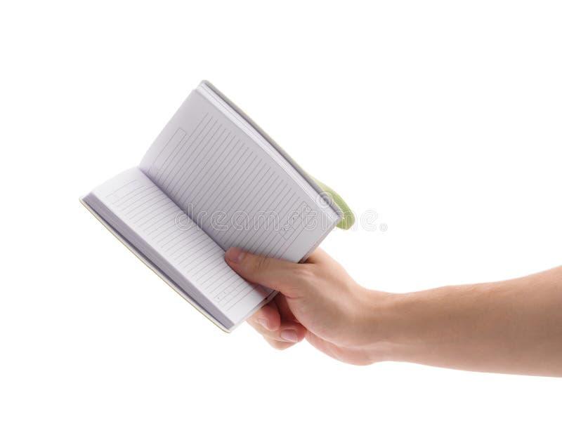 Bloco de notas verde Para fazer a lista Mão do ` s do homem que guarda o bloco de notas imagens de stock royalty free