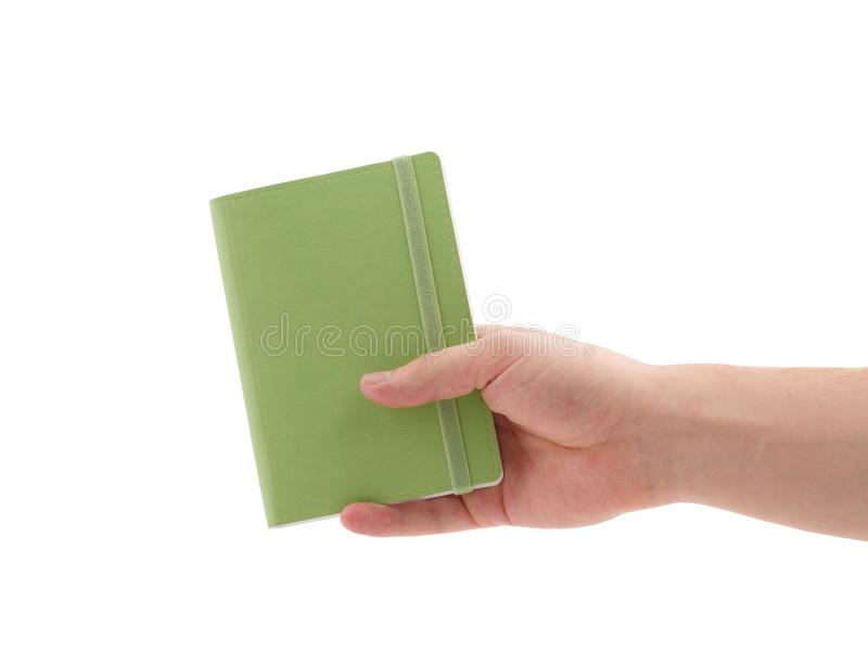 Bloco de notas verde Para fazer a lista Mão do ` s do homem que guarda o bloco de notas imagem de stock royalty free