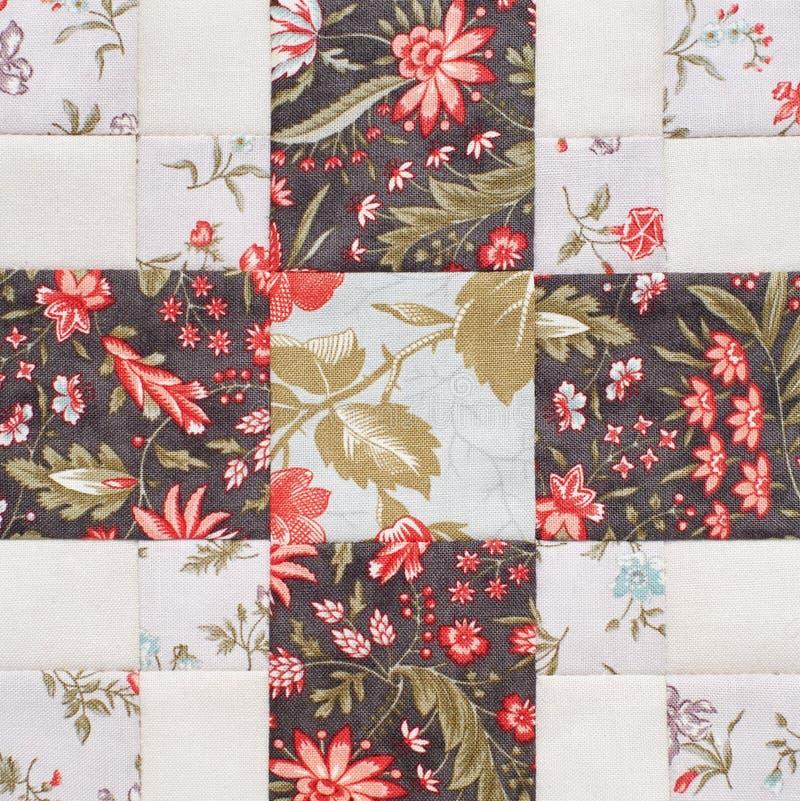 Bloco geométrico pastel das partes de telas, detalhe de edredão, close-up dos retalhos imagem de stock royalty free