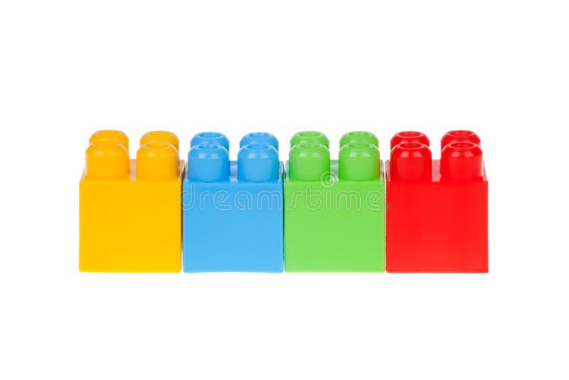 Blocos de apartamentos plásticos coloridos isolados no branco fotos de stock