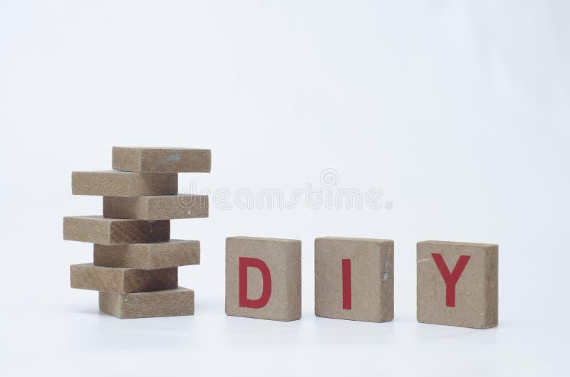Blocos de madeira com a palavra de DIY foto de stock royalty free