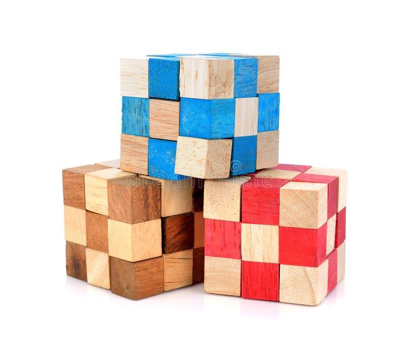 Blocos de madeira do enigma do cubo fotografia de stock royalty free