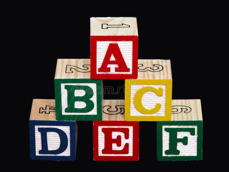 Blocos do alfabeto (A-F) no preto fotos de stock