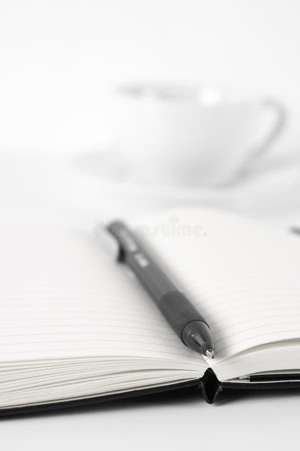 Blocs-notes avec le stylo et le café photo libre de droits