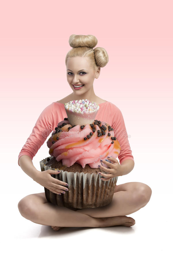 Blode Girl With Big Cupcake Royalty Free Stock Photography