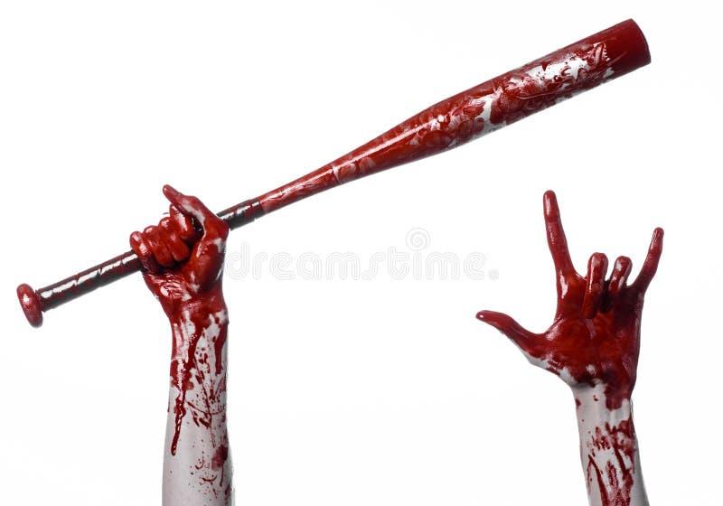 Blodig hand som rymmer ett baseballslagträ, ett blodigt baseballslagträ, slagträ, blodsport, mördare, levande död, halloween tema royaltyfria foton