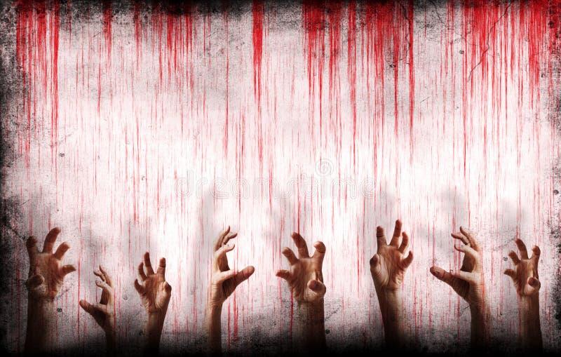 Blodig vägg med läskiga händer arkivfoton