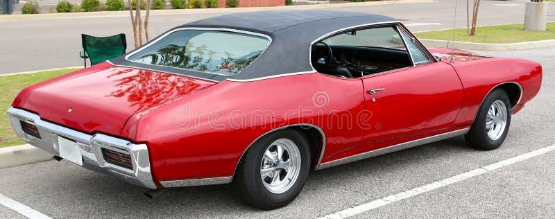 1969 Bloed Rood Klassiek Pontiac GTO stock foto's