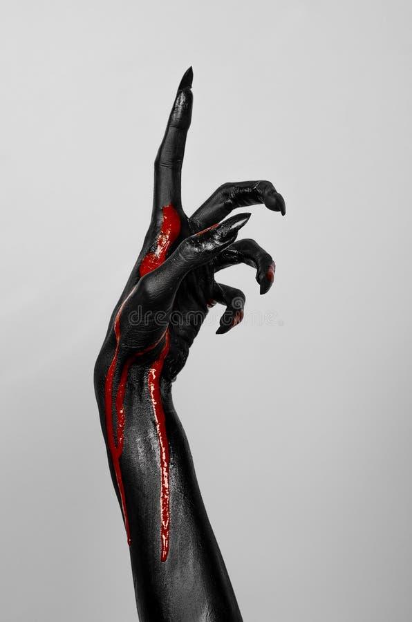 Bloedige zwarte dunne hand van dood royalty-vrije stock afbeelding