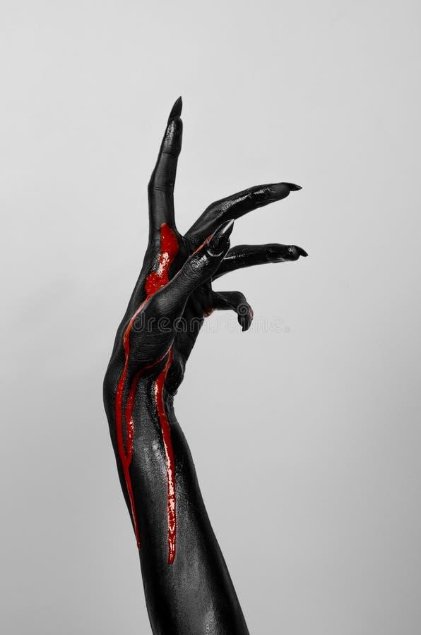 Bloedige zwarte dunne hand van dood stock foto's