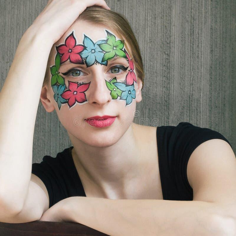 Bloemen het facepainting stock foto