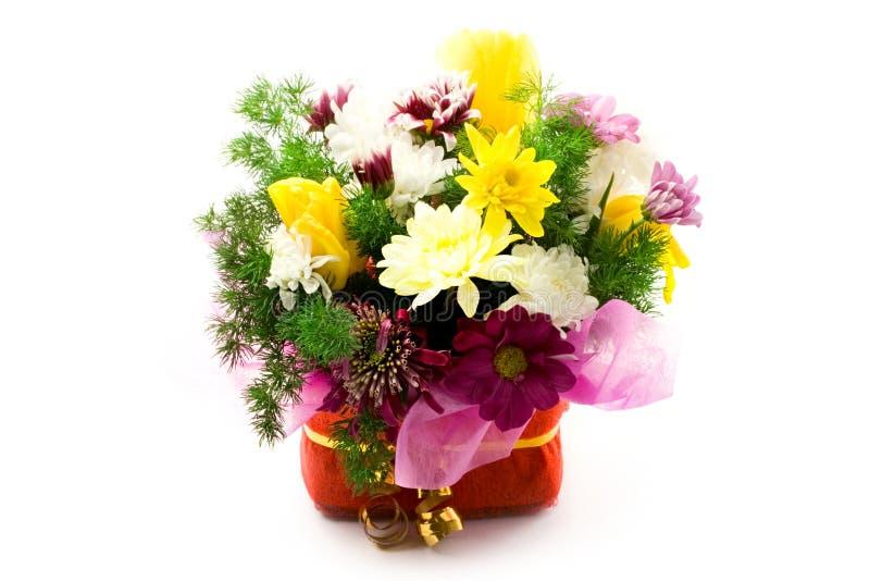 Bloemen in mand stock foto's