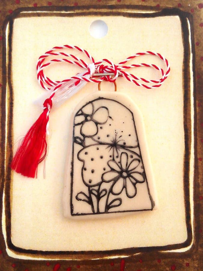 Bloemenmedaillon met rood en wit koord royalty-vrije stock afbeeldingen
